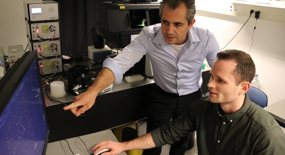 Nikos Hatzakis and Simon Bo Jensen operating the advanced fluorescence microscope. Credit: Shunliang Wu