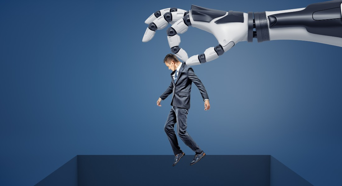 Photo of a man being held over a cliff by a robotic arm