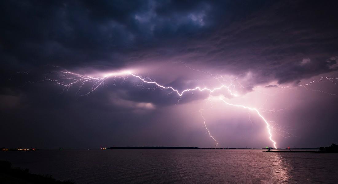Photo of a dark sky with white lightening