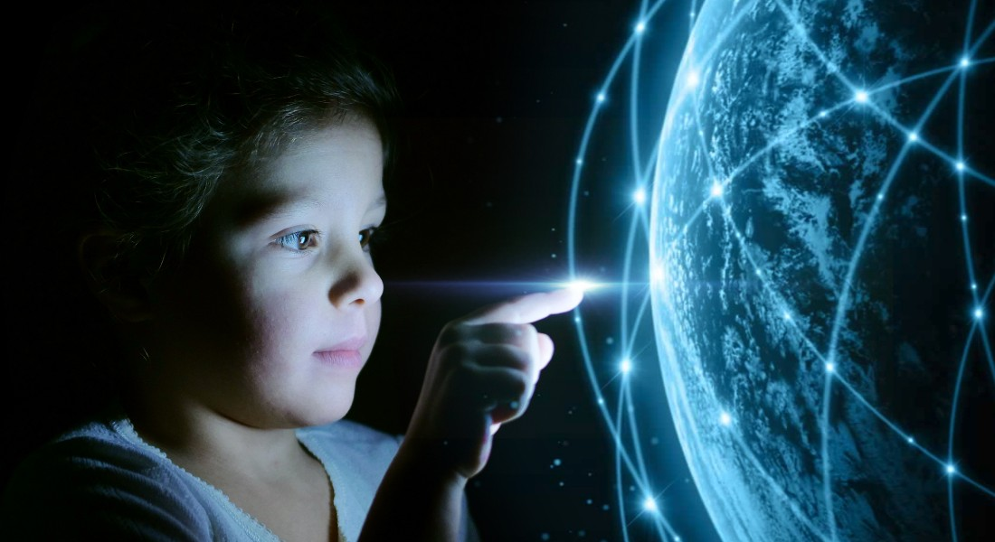 Photo of a oyung boy looking at a futuristic world