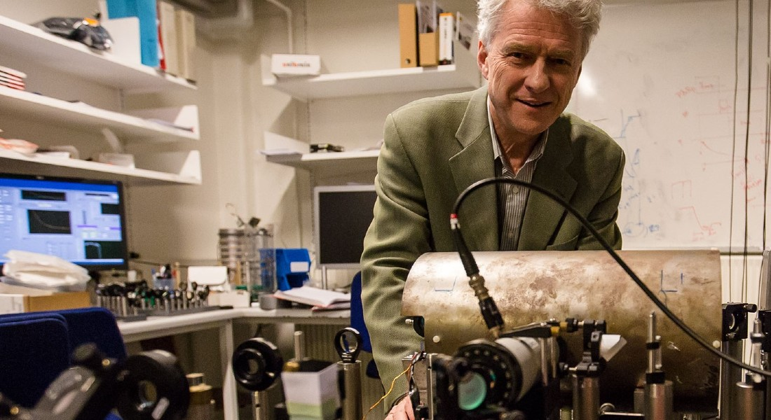Photo of researcher Eugene Simon Polzik in his lab working with quantum bits of light. By Eugene Simon Polzik